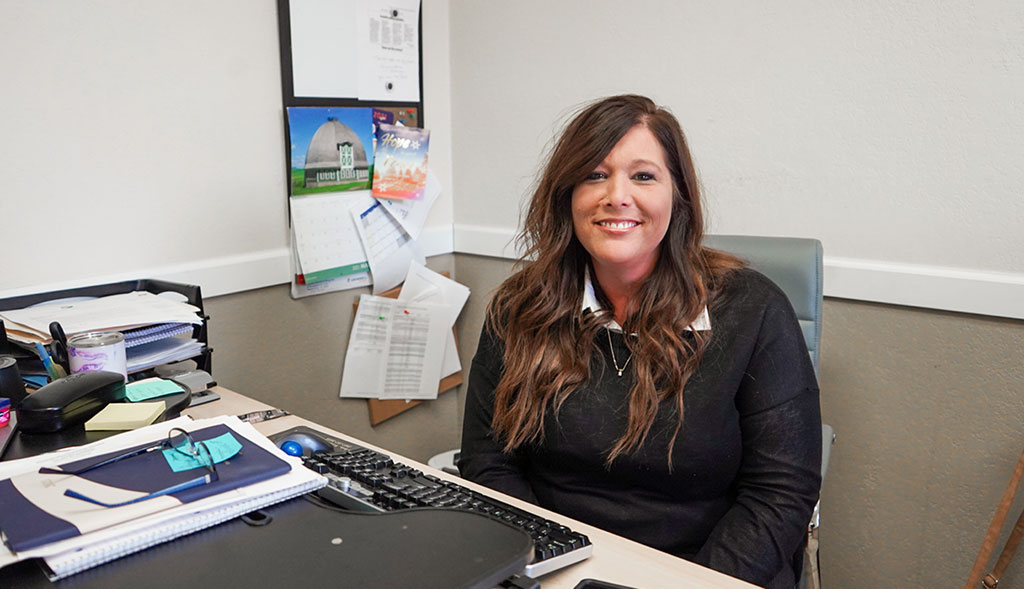 WellSpring Home Health employee works at her desk.