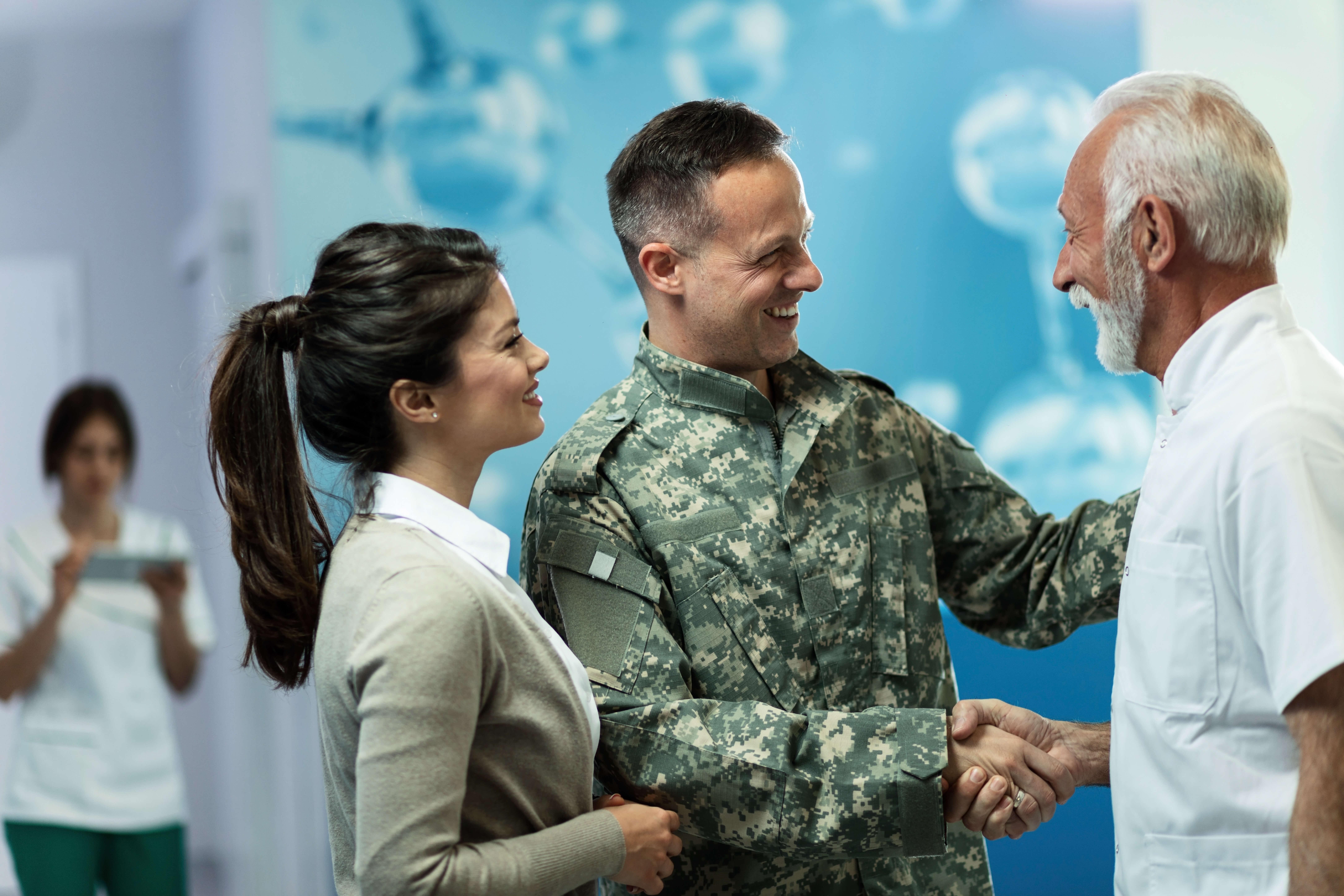 Veteran in uniform greets father.