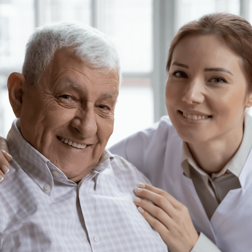 Home healthcare worker assists with older man.