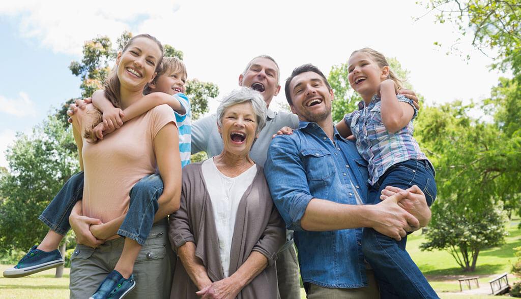 Multi-generational family enjoys time together outside.